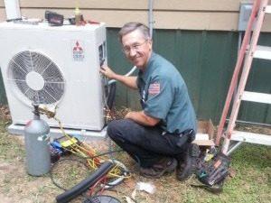 HVAC Technician working on an AC unit.